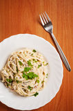 Fettuccine carbonara in a white bowl Royalty Free Stock Photos