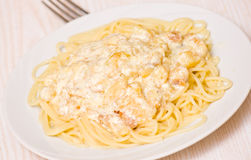 Spaghetti with fish and cream sauce Royalty Free Stock Photos