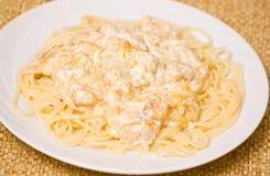 Spaghetti with fish and cream sauce Stock Image