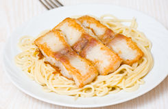 Spaghetti with fish Stock Images