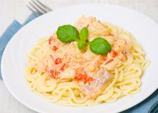 Spaghetti with fish, vegetables and cream sauce Royalty Free Stock Photography