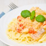 Spaghetti with fish, vegetables and cream sauce Stock Photos