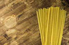 Spaghetti floor frame wooden background. Top view Stock Photo