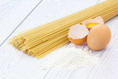 Spaghetti flour and eggs Stock Photo