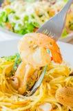 Spaghetti. Focus on shrimp in spagetthi dish Stock Photo
