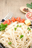 Spaghetti food and vegetables spices on wood Stock Image