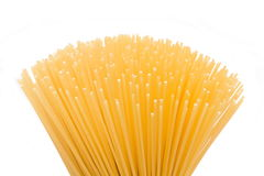 Spaghetti in the foreground. On a white background Royalty Free Stock Photography