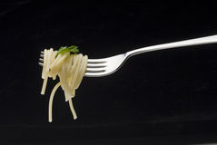 Spaghetti fork. Delicious and nourishing mouthful of spaghetti fork Royalty Free Stock Images