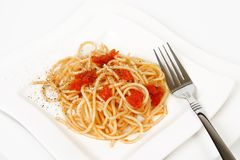 Spaghetti and fork. Spaghetti with sundried tomato sauce stock photo