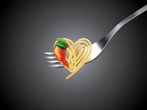 Spaghetti on fork with tomato sauce and basil Royalty Free Stock Photos