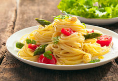 Spaghetti with fresh green asparagus Stock Photography