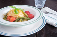 Spaghetti with fresh green beans and cherry tomatoes Royalty Free Stock Photography