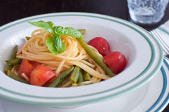 Spaghetti with fresh green beans and cherry tomatoes Stock Images