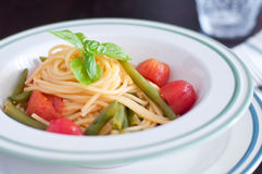 Spaghetti with fresh green beans and cherry tomatoes Royalty Free Stock Photo