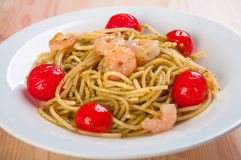 Spaghetti with fresh shrimps and tomatoes Royalty Free Stock Photography
