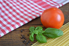 Spaghetti, fresh tomato and basil Stock Photos