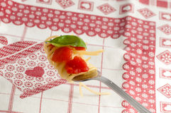 Spaghetti with fresh tomato rolled on fork Stock Photo