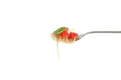 Spaghetti with fresh tomato rolled on fork. Traditional Italian Royalty Free Stock Photo