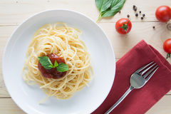 Spaghetti with fresh tomatoes basil italian herbs Royalty Free Stock Photos