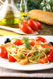 Spaghetti with fresh tomatoes, olives and mint Stock Photo