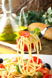 Spaghetti with fresh tomatoes, olives and mint Royalty Free Stock Image