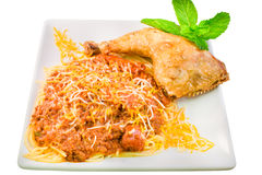 Spaghetti with fried chicken and sliced sausage link Royalty Free Stock Photo