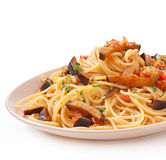 Spaghetti with fried eggplant and tomatoe Royalty Free Stock Images