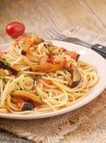 Spaghetti with fried eggplant and tomatoe Stock Photos