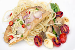 Spaghetti with fried fish, garlic and chili in thai cuisine, On Royalty Free Stock Photo