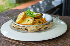 Spaghetti with garlic bread. Spaghetti with garlic bread on wood table Royalty Free Stock Photography