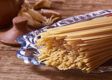 Spaghetti and Garlic. Ingredients for pasta with garlic, the garlic was kept in beautiful ceramic pots and prepared on an old rustic table royalty free stock photo