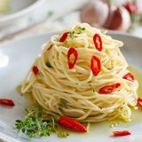 Spaghetti with garlic, olive oil and hot red pepper. Close up stock image