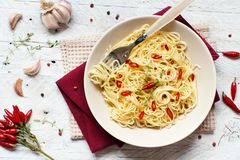 Spaghetti with garlic, olive oil and hot red pepper. Top view royalty free stock image