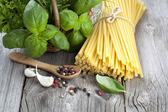 Spaghetti with garlic, peppers, and fresh basil leaves Royalty Free Stock Photography