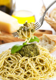 Spaghetti with genoese sauce on fork above plate Royalty Free Stock Photos