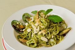 Spaghetti Genovese with Seafood Stock Images