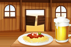 A spaghetti and a glass of beer inside the saloon bar Stock Photography
