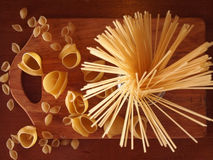 Spaghetti. In a glass jar of pasta seashells Royalty Free Stock Photo