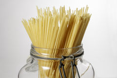 Spaghetti in glass jar  on white background Stock Image