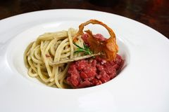Spaghetti gourmet with tartare. Italian spaghetti special composition with tatare Royalty Free Stock Image