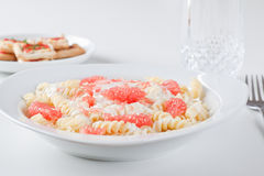 Spaghetti with a grapefruit and goat cheese sauce Stock Photos