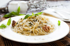 Spaghetti with grated Parmesan and basil Royalty Free Stock Image