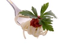 Spaghetti with grawy on the fork close-up Royalty Free Stock Photos