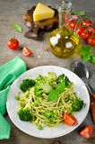 Spaghetti with green peas and basil pesto Royalty Free Stock Images