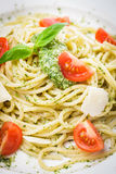 Spaghetti with green pesto Stock Photo