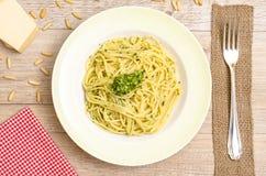 Spaghetti with green pesto on a plate Royalty Free Stock Photos