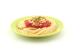 Spaghetti on green plate. Delicious spaghetti on green plate royalty free stock photography
