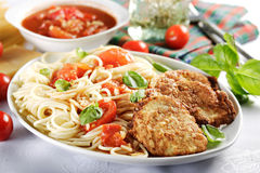 Spaghetti with grilled meat Stock Photos