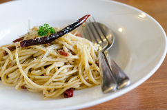 Spaghetti with ham , bacon, chilli and basil Stock Images