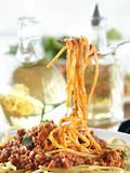 Spaghetti hanging on a fork at dinner Stock Image